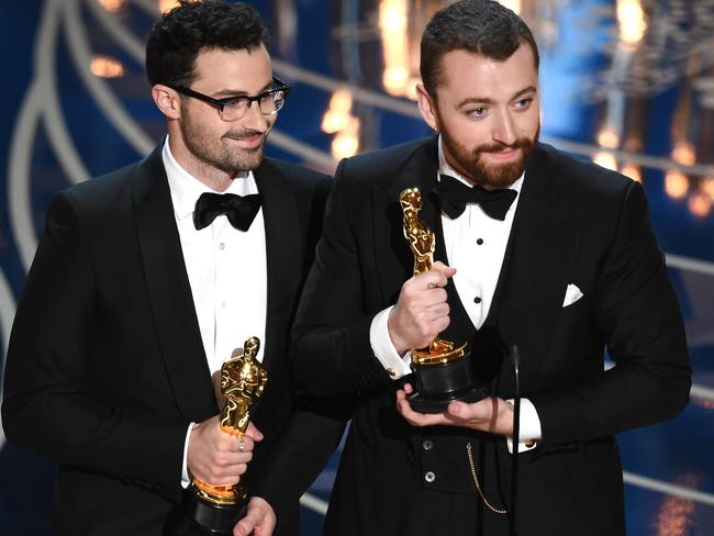 Songwriter Jimmy Napes and Sam Smith accept the Best Original Song award.