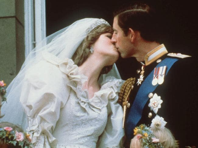 Fairytale wedding ... Prince Charles kisses his bride, the former Diana Spencer, on July 29, 1981, on the balcony of Buckingham Palace. Picture: AP