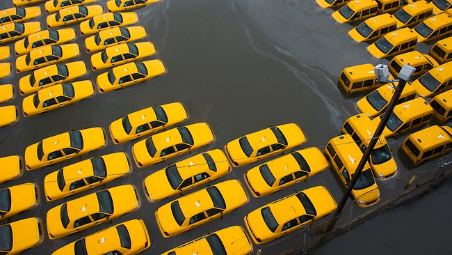 A parking lot full of yellow cabs is flooded as a result of superstorm Sandy in Hoboken, NJ. Picture: Charles Sykes