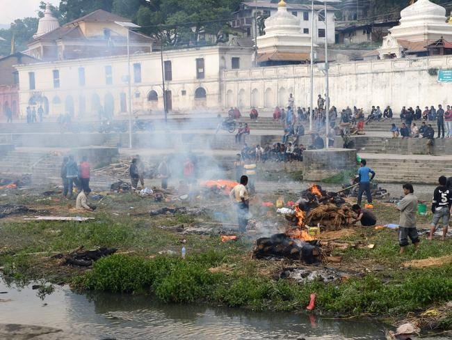 Cremation ... people burn the bodies of earthquake victims at a mass cremation in Kathmandu. Picture: AFP/Prakash Mathema