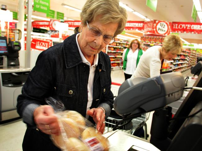 Grace Ursini (83), uses the self-serve checkout at the Coles supermarket in Burnside, South Australia. She finds it quicker than queueing for a staffed checkout.