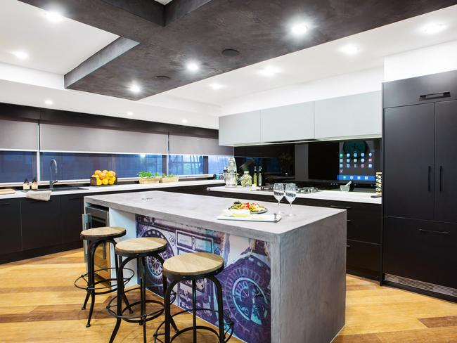 Caro and Kingi's kitchen with the hi-tech splashback.