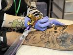 Australian Tattoo and Body Art Convention at the PCEC. Allie Derbyshire tattooing Riki Taite.