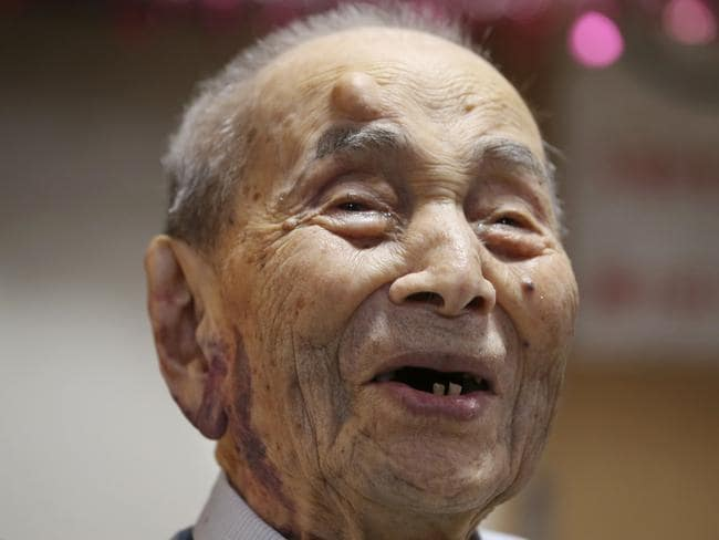 Happy man ... Yasutaro Koide smiles upon being formally recognised as the world's oldest man by the Guinness World Records before he passed away. Picture: AP