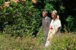 <p>A picture shows freed anti-apartheid leader and African National Congress (ANC) member Nelson Mandela (left) and his wife Winnie in the garden of Archbishop Desmond Tutu's residence in Cape Town, one day after the release from jail of Nelson Mandela.</p>