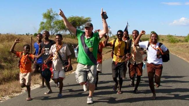 Running with the locals in Madagascar. Picture: Newsmodo