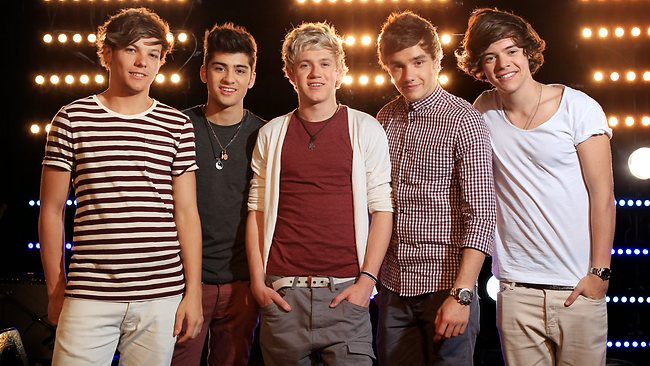 One Direction's singers ... (From left) Louis Tomlinson, Zayn Malik, Niall Horan, Elle Halliwell, Liam Payne and Harry Styles in Sydney. Picture: Sam Ruttyn