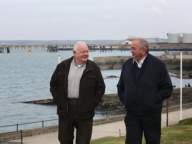 Change ahead ... Holyhead mayor Ronnie Williams with councillor and incoming mayor John Owen at the Marina with the jetty in the background where ships with alumina and coke coming from Australia were docking. Picture: Ella Pellegrini