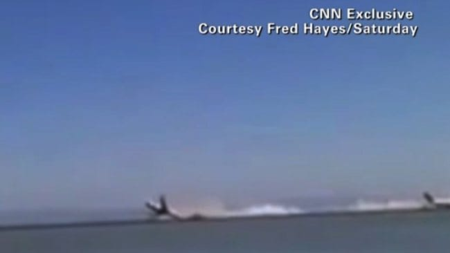 The plane flips upwards as the landing goes horribly wrong. Picture: Fred Hayes via CNN