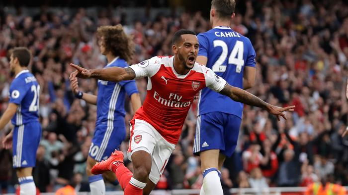 Arsenal's Theo Walcott celebrates after scoring his side's second goal during the English Premier League soccer match between Arsenal and Chelsea at the Emirates Stadium in London, Saturday, Sept. 24, 2016. (AP Photo/Matt Dunham)
