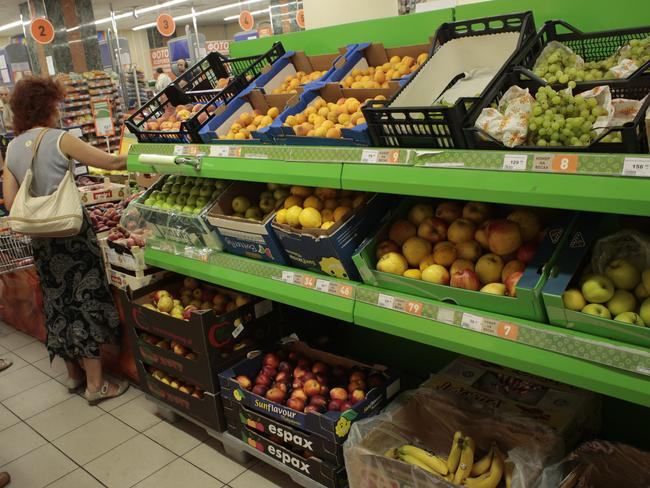 People buy imported fruit at a supermarket in Moscow yesterday. Picture: Ivan Sekretarev