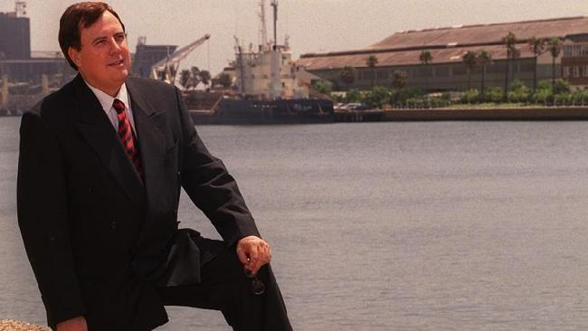 Clive Palmer, in the obligatory ?thinking deeply near water with knee raised? pose.