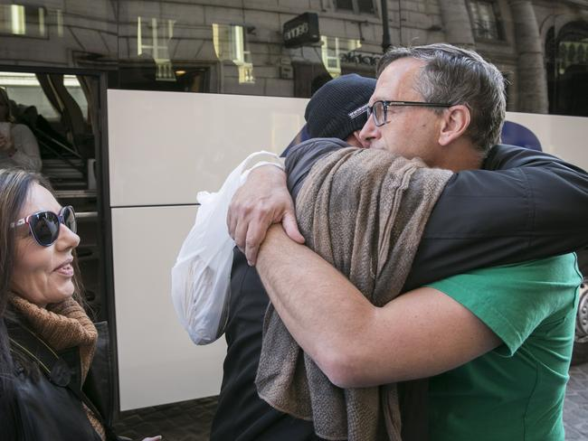 David Ridsdale gets a much needed hug from Michele and Paul Levey. Picture: Ella Pellegrini