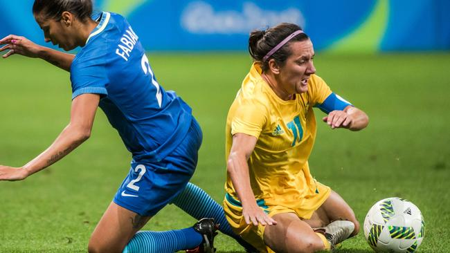 Matildas star Lisa De Vanna (right) and Brazil's Fabiana compete for the ball at the Rio Olympics.