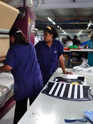 Workers at ISC Sports in Fiji making Port Adelaide's prison-bar jumper ahead of Sunday's elimination final against Richmond at Adelaide Oval. Pictures: ISC Sport/Twitter