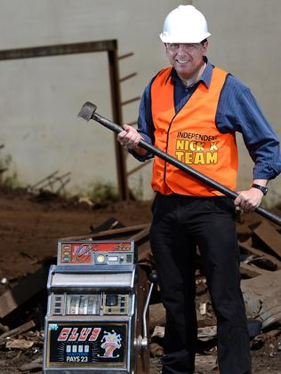 Senator Nick Xenophon crushing a pokie machine at a scrap metal yard earlier this year.