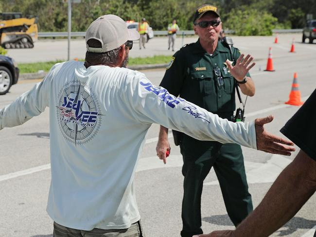 A Florida Keys resident argues with law enforcement officers who are preventing people from returing to their homes. Picture: Getty/AFP
