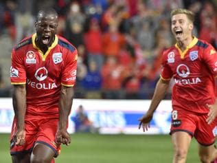 Bruce Djite of United (L) reacts after scoring goal during the A-League semi-final between Adelaide United and Melbourne City at Coopers Stadium in Adelaide, Friday, April 22, 2016. (AAP Image/David Mariuz) NO ARCHIVING, EDITORIAL USE ONLY