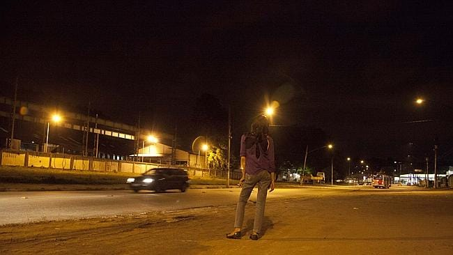Young prostitute waiting for business on the road by the Sao Paulo slum. Picture: Jota Roxo