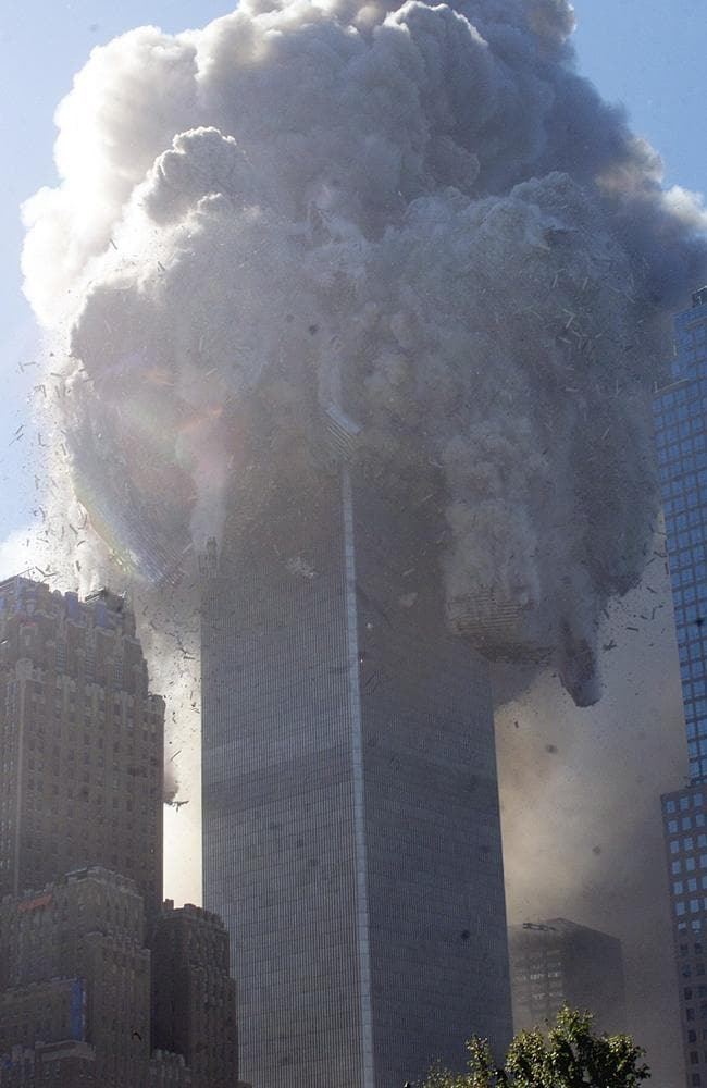 Conspiracists say the Twin Towers would never have blown debris out so far without explosives. Because apparently they're experts in what happens when huge buildings collapse. (AP Photo/Richard Drew)