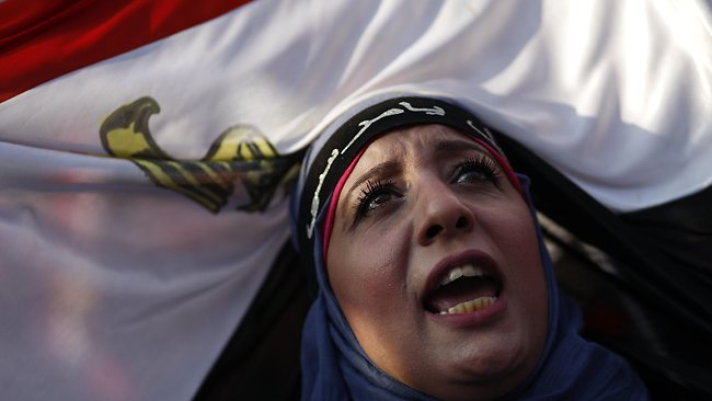 Egyptian women shout slogans against President Mohammed Morsi as Egyptian national flags are waved as hundreds of thousands demonstrate against him in Cairo, Egypt. AFP PHOTO / MAHMOUD KHALED