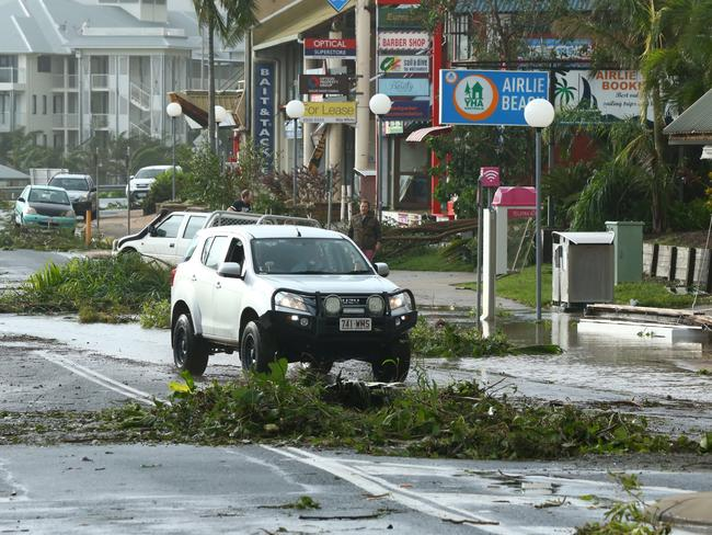 The streets of Airlie Beach are littered with fallen tree branches. Picture: Liam Kidston