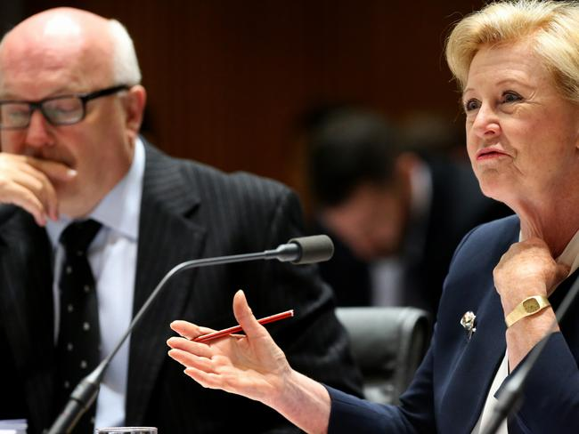 George Brandis listens as Human Rights Commission president Professor Gillian Triggs speaks at Senate Estimates in Canberra. Picture: Ray Strange