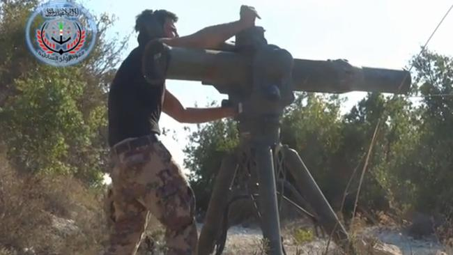 Armed ... A Syrian rebel fighter uses an American-made weapon. Picture: Supplied