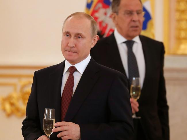 Vladimir Putin and Russian Foreign Minister Sergey Lavrov at a ceremony of receiving credentials from foreign ambassadors in the Kremlin. Picture: AP
