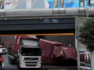 Truck stuck after driving under Napier street bridge Footscray. Picture: Nicole Garmston