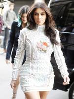 Bridezilla? ... Kim Kardashian is seen wearing an ornate white Balmain mini-dress as she arrives at Costes restaurant in Paris. Picture: Splash