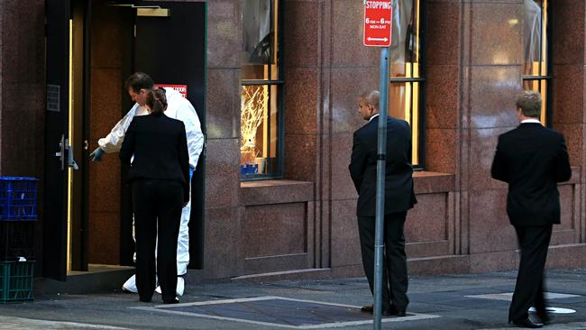 Investigators examine the crime scene at the Lindt Cafe in Martin Place, Sydney where two hostages lost their lives in the December 2014 siege. Picture: Craig Greenhill