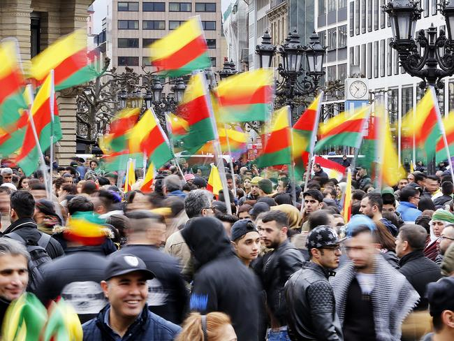 Kurdish people living in Germany celebrated the Newroz spring festival and protested against Turkish President Erdogan over the weekend. (AP Photo/Michael Probst)