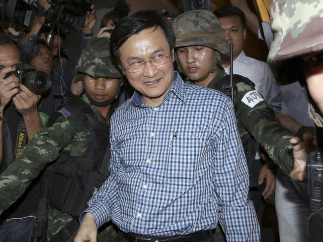 Spectacle ... Former Thai Education Minister Chaturon Chaisang, centre, walks after being detained by soldiers after a news conference at the Foreign Correspondents' Club of Thailand in Bangkok, Thailand. Picture: Apichart Weerawong