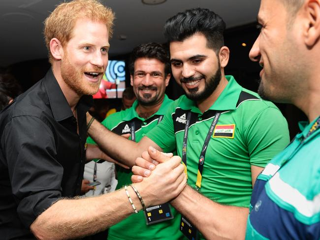Prince Harry, pictured with Iraqi athletes, also created the Invictus Games which helps wounded, injured or sick armed services personnel. Picture: AFP/Nathan Denette