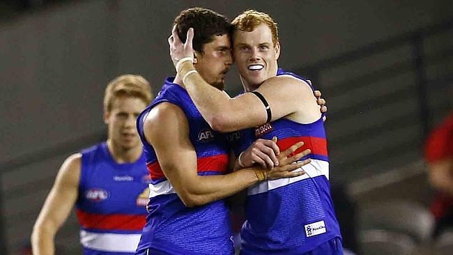 Cooney celebrates a goal with Bulldogs young gun Tom Liberatore. Picture: Michael Klein
