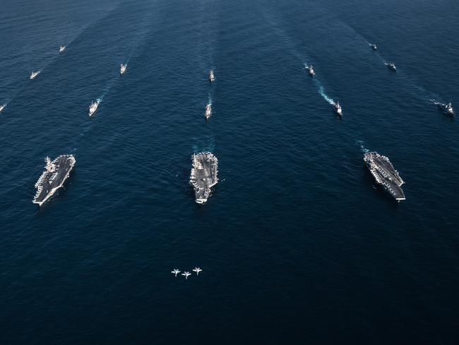 This image released by the US Navy on November 12, 2017, shows three F/A-18E Super Hornets fly in formation over the aircraft carriers USS Ronald Reagan, USS Theodore Roosevelt, USS Nimitz and their strike groups along with ships from the Republic of Korea Navy as they transit the Western Pacific.