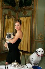 Tara Palmer-Tomkinson with French Bull Dog 'Maude' and Dalmation 'Phoebe' at the Clivedon Hotel in Berkshire for the launch of the film Hotel for Dogs. Geoff Caddick/PA Wire