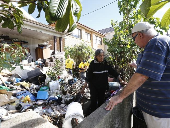 A council representative tells Mary Bobolas to vacate the property. Picture: Bradley Hunt