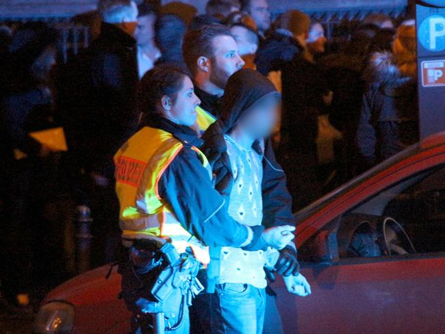 Nabbed ... police arrest a man on New Year's Eve in Cologne, Germany. Picture: AFP/DPA/Markus Boehm