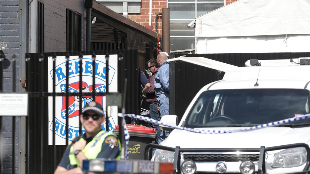 Tasmania Police at the Rebels Motorcycle Club clubhouse on the corner of Letitia and Burnett streets in North Hobart.