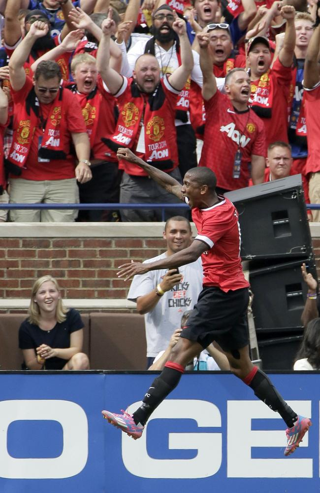 Ashley Young celebrates one of his first-half goals for Manchester United against Real Madrid.