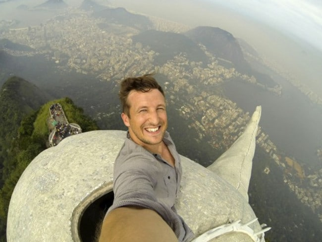 One of a kind ... Lee Thompson takes his epic selfie from inside the head of Christ the Redeemer. Picture: Lee Thompson/The Flash Pack UK
