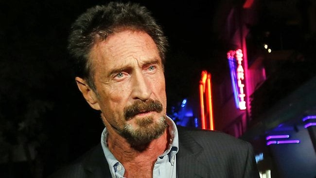 Anti-virus software founder John McAfee wants to be questioned about his neighbour's death in a neutral country.