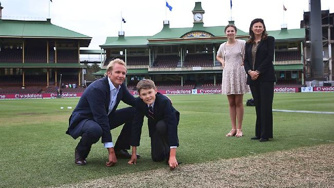 Tony Greig's young son Tom mimics his dad's trademark of putting a key in the wicket with Mark Greig, Tony's oldest son, Tony's wife Vivian and daughter Beau.
