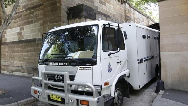 Facing your destiny: a prison van brings an accused inmate to the NSW Supreme Court at Darlinghurst to face a trial for the murder of his girlfriend. Picture: News Limited.