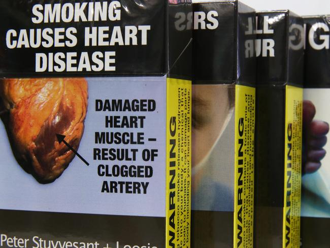 Plain packaging ... research suggests it is having an impact on the number of young people taking up the habit.