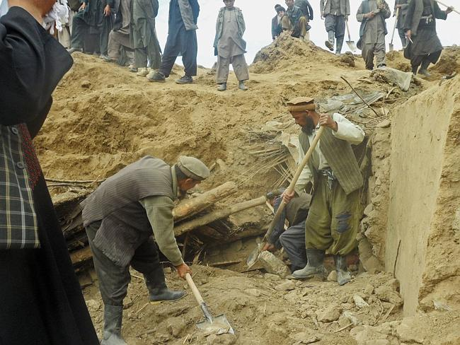 Thousands missing...Afghan rescuers and hundreds of volunteers armed with shovels rushed on Saturday to help villagers hit by a massive landslide, while fears of a new torrent of mud and earth complicated rescue efforts. Picture: AP