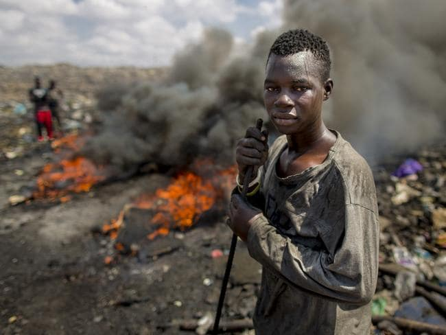 Teenage boy living on the world's worst dump at Agbogbloshie in Ghana, where Australian computer waste is illegally dumped and African children die early in the toxic environment. Picture: Thomas Imo.