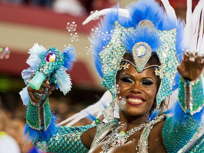 Samba battle ... A member of Salgueiro Samba School performs during their parade at 2014 Brazilian Carnival at Sapucai Sambadrome on March 02, 2014 in Rio de Janeiro, Brazil.